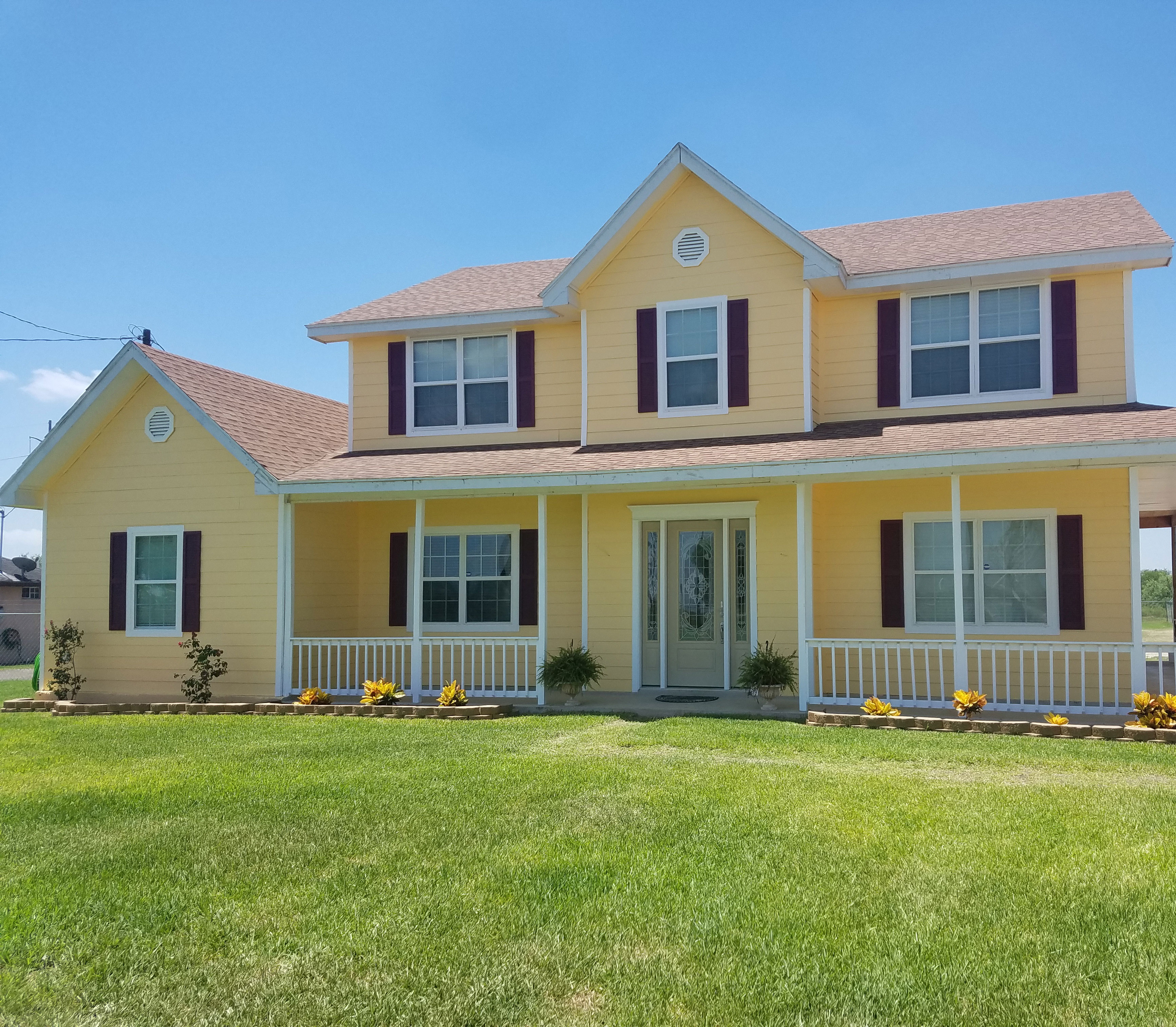 Berry red shutters on yellow home architectural depot for Yellow and red house