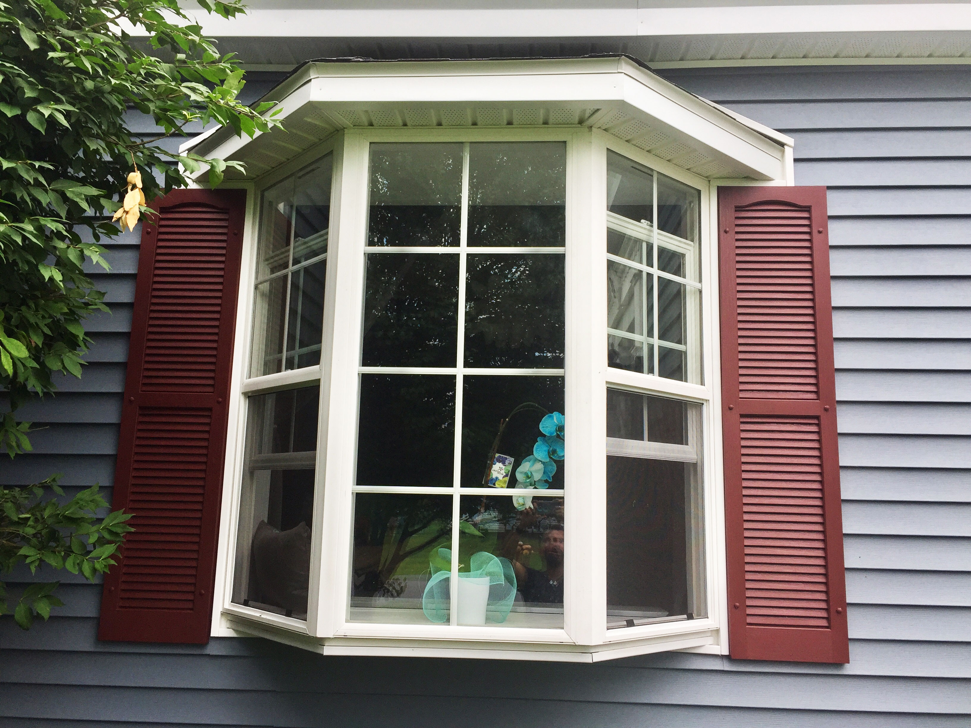 Cranberry Shutters On Home In New York
